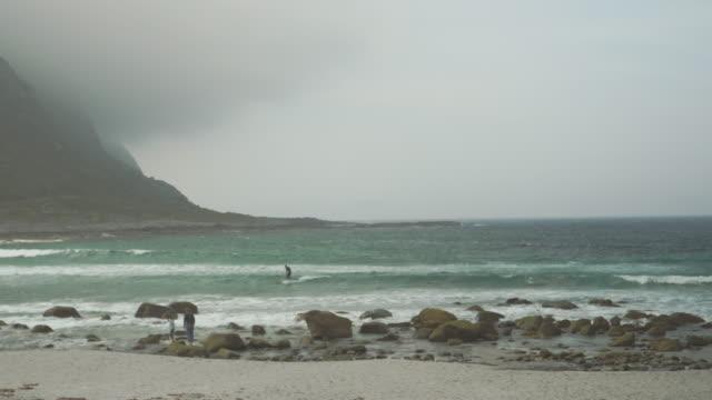 Kite surfer on waves in waters outside Godöya Ålesund Norway
