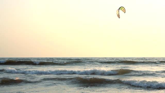 Kiteboarder enjoy surfing in the sea video
