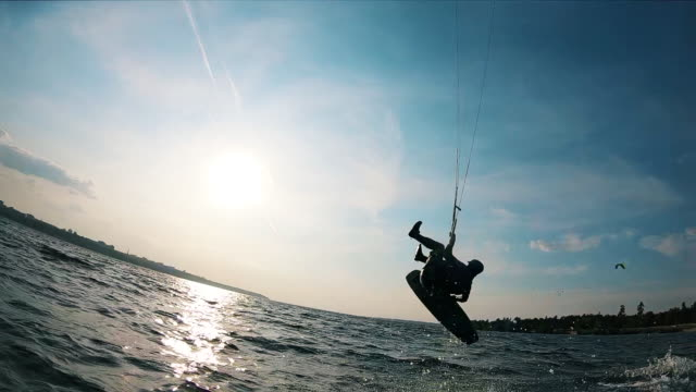 Kiteboarding man is doing a trick in slow motion