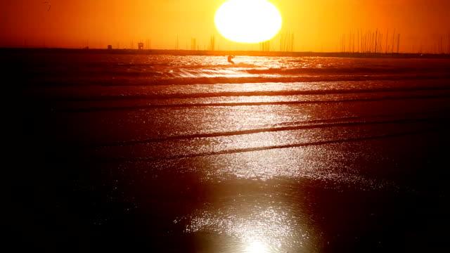 Kiteboarding on sunset video