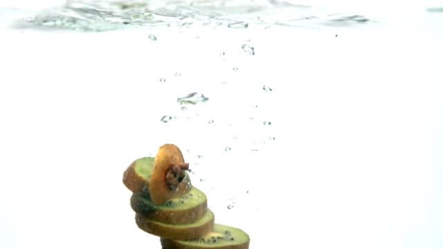 Kiwi falling into water, in slow motion video