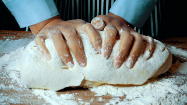 kneading dough with hands kneading dough with hands garnish stock videos & royalty-free footage