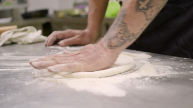 kneading pastry in flour on kitchen counter - formare pane video stock e b–roll