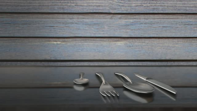 vidéos et rushes de couteau et cuillères sur une table en verre mise au point sélective - pots de bureau