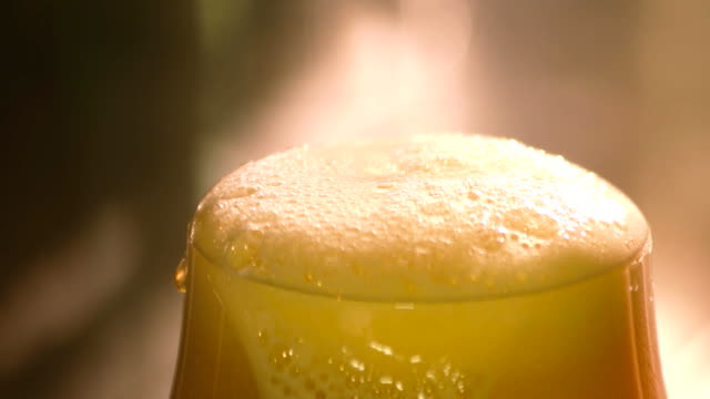 Knife cutting froth from beer. video