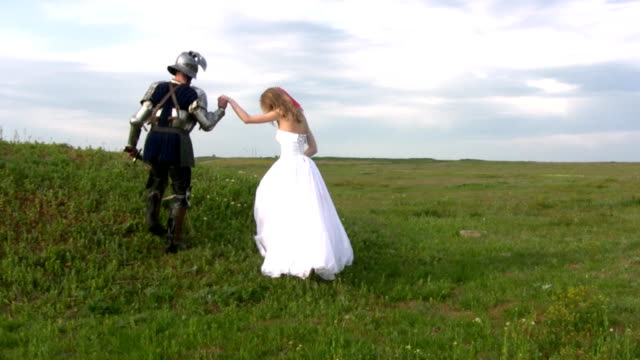 knight and bride up the hill - renaissance architecture stock videos & royalty-free footage