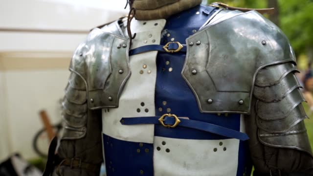 A knight in body armor on a traditional festival
