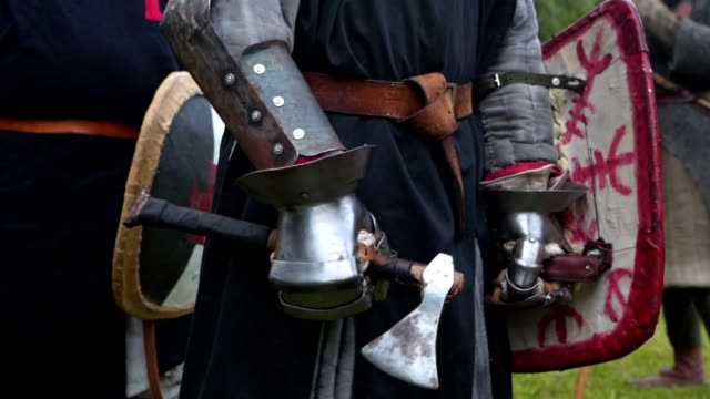 A knight in body armor with a long sword standing at a medieval festival Medieval warrior with body armor on a traditional festival. renaissance architecture stock videos & royalty-free footage