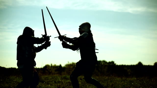 Knights fighting on the battlefield Knights fighting on the battlefield. knight person stock videos & royalty-free footage