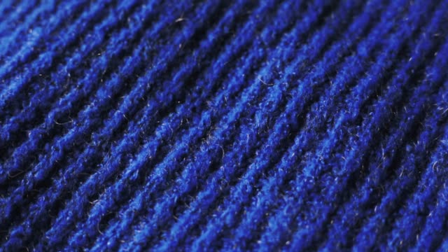 knitted fabric in blue color. can be used as background - материал стоковые видео и кадры b-roll