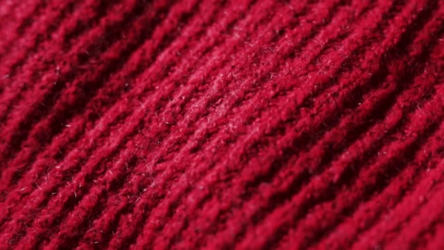 Knitted fabric in redcolor. Can be used as background video