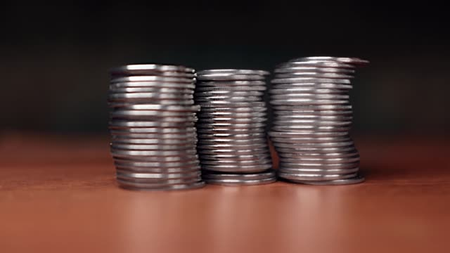 Knock down a stack of coins with a click.