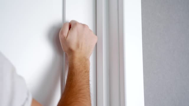 Knocking Door with Hand Close Up Banging on the Door Knocking Door with Hand Close Up Banging on the Door. salesman stock videos & royalty-free footage