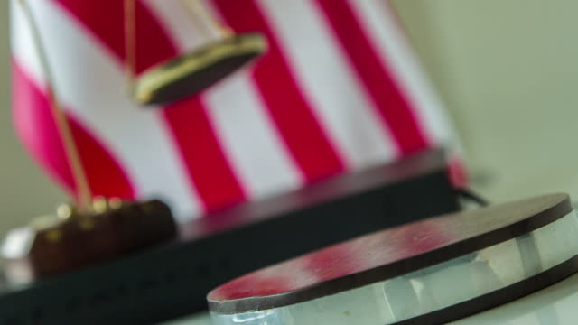Knocking wooden gavel with American flag background video