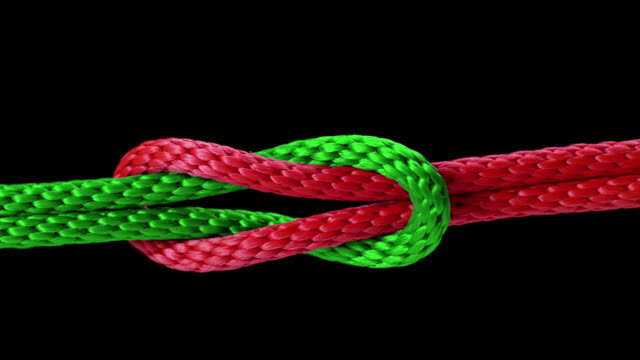 SLO MO LD Knot being tied with a red and green rope