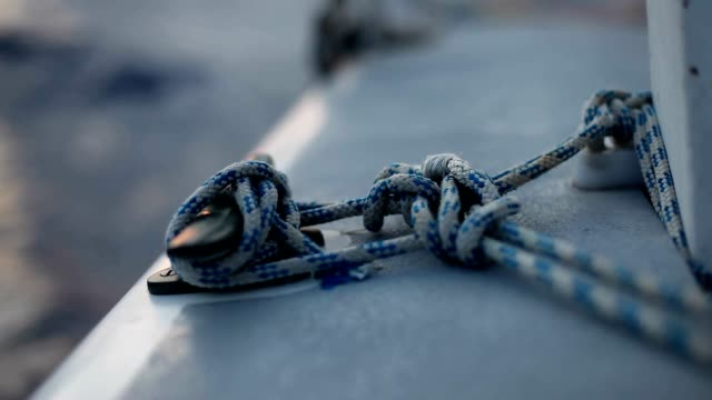 Knot made on a boat. Secure knot on a boat while sailing video