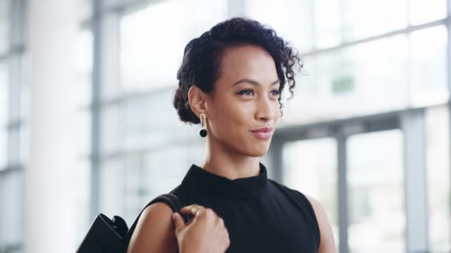 Know your passion and fill it with purpose 4k video footage of a confident young businesswoman walking through a modern office focus stock videos & royalty-free footage