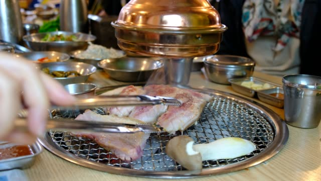 korean barbecue stoves with chacoal inside ready for yakiniku. (jeju pork belly) - corea del sud video stock e b–roll