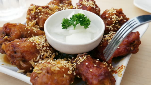 korean food fried chicken with spicy sauce - cultura coreana video stock e b–roll