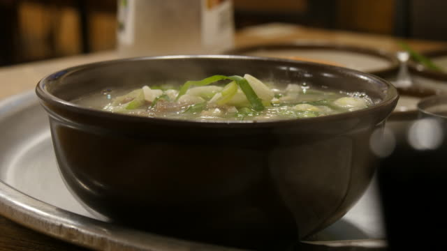 Korean pork soup in a restaurant Korean pork soup in a restaurant cabbage stock videos & royalty-free footage