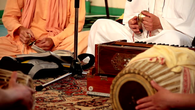 Krishna playing on traditional Indian musical instruments and  sing prayers video
