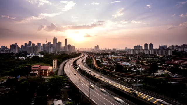 kuala lumpur con tramonto, time lapse - malaysia video stock e b–roll