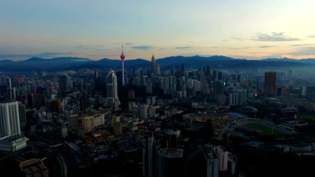 Kuala Lumpur City skyline from aerial view during sunrise video