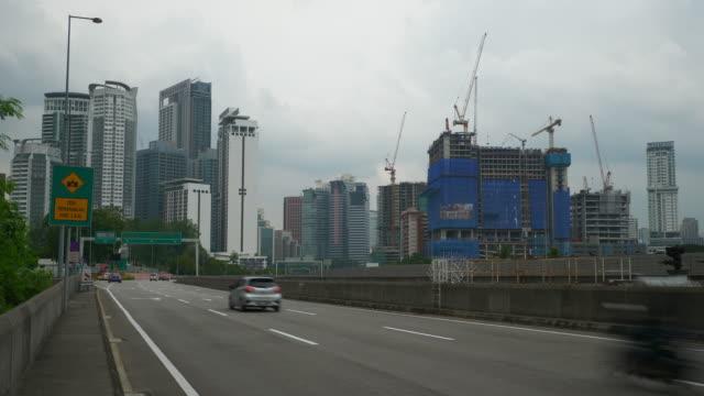 kuala lumpur city traffic road side construction panorama 4k malaysia - malaysia video stock e b–roll