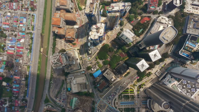 kuala lumpur downtown sunny day famous towers traffic square aerial topdown panorama 4k malaysia - kuala lumpur video stock e b–roll
