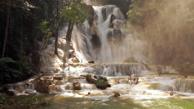 kuang si waterfall, luang prabang, laos - monsone video stock e b–roll