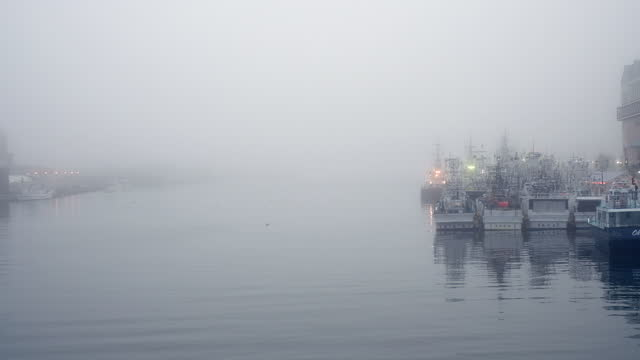 Kushiro River with boats on a foggy afternoon