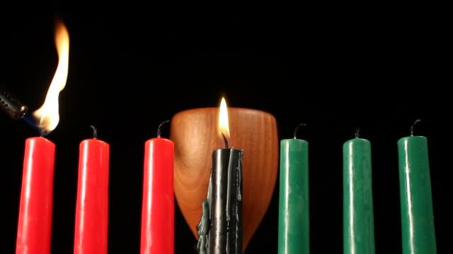 kwanzaa candle lighting order - kwanzaa stock videos and b-roll footage