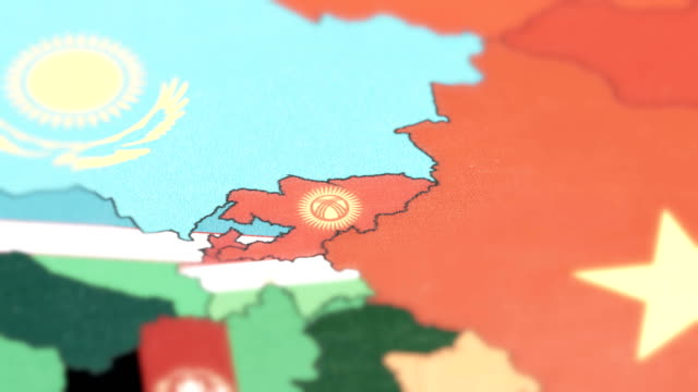 Kyrgyzstan with National Flag on World Map tracking to Kyrgyzstan with National Flag on World Map china east asia stock videos & royalty-free footage