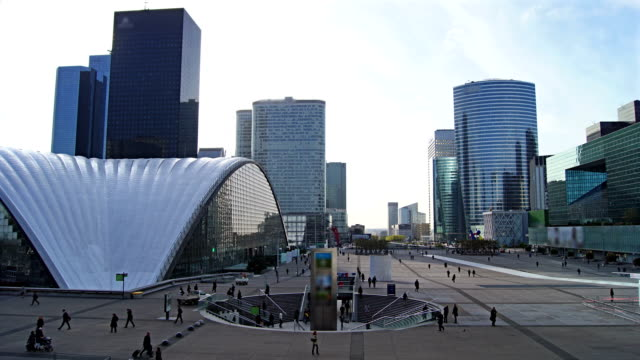 La Defense, Paris, time lapse  La Defense Parisian business district bristling with skyscrapers that started life in the 1960's. Logo was removed, time lapse. post modern architecture stock videos & royalty-free footage