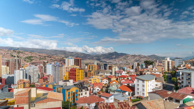 la paz, bolivia, timelapse view of cityscape showing residential buildings and andes mountains during daytime - vivid 4k video stock videos & royalty-free footage