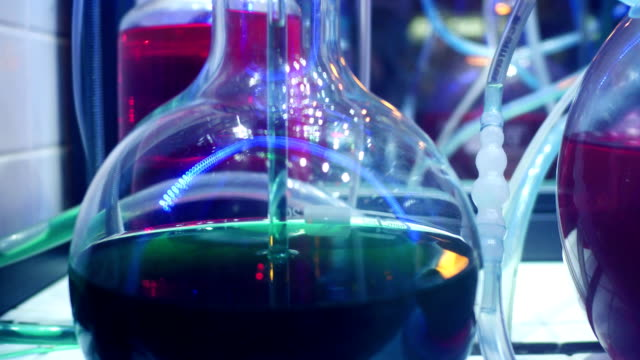 lab equipment close up and colorful liquids - reagente video stock e b–roll