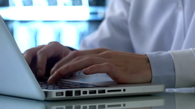 lab expert typing medical report laptop, entering data record, research results - близко к стоковые видео и кадры b-roll