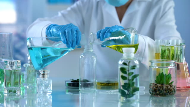 Lab researcher mixing extract liquid in bottle, aromatherapy, organic spray Lab researcher mixing extract liquid in bottle, aromatherapy, organic spray herb stock videos & royalty-free footage
