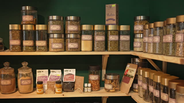 Labeled jars of different dried tea on the shelf at the modern health food store shop Labeled jars of different dried tea on the shelf at the modern health food store shop natural condition stock videos & royalty-free footage