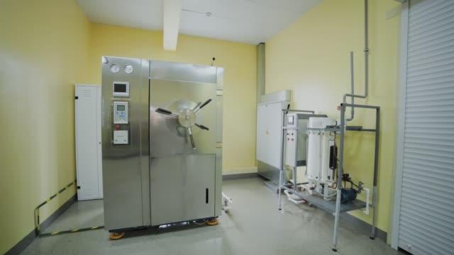 laboratory autoclave room for sterilization - autoclave video stock e b–roll