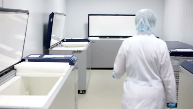 Laboratory cold storage Technician opens laboratory cold storage freezer stock videos & royalty-free footage