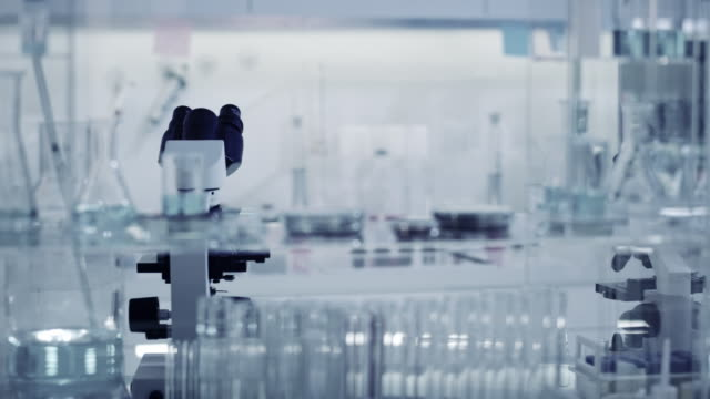 Laboratory equipment. Microscope and glassware