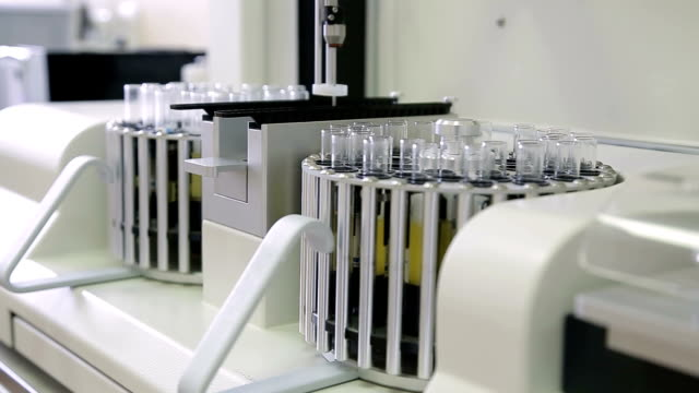 Laboratory machine for analysis of urinalysis. Test tubes close-up. video