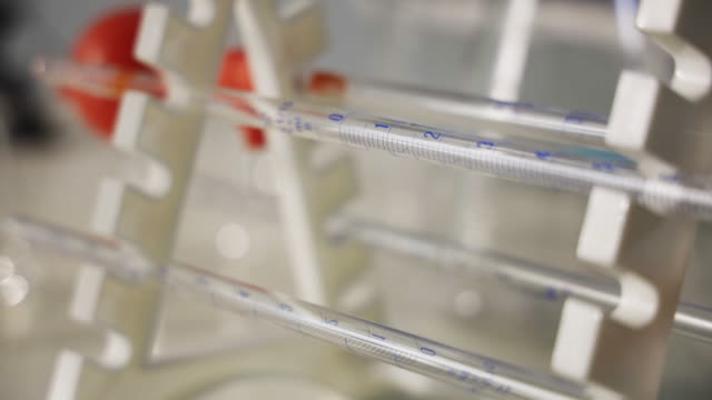 laboratory research.pipette rack with filler, holds pipettes horizontally - autoclave video stock e b–roll