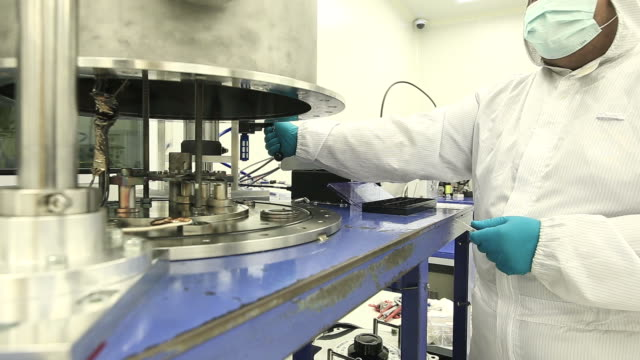 Laboratory technicians working in clean room video