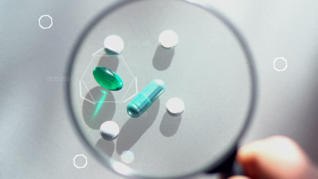 Laboratory tests. Pills lying on the table. Close-up on medicines video