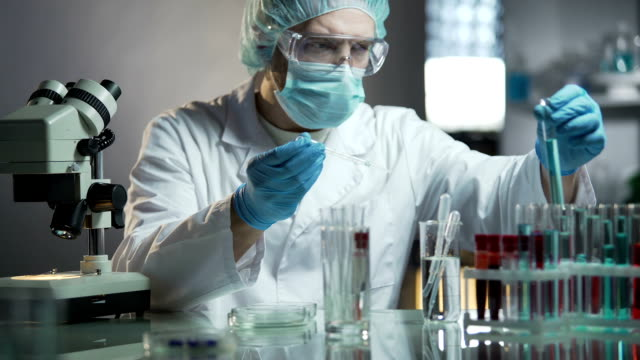 Laboratory worker calculating exact formula of hypoallergenic cosmetic products video