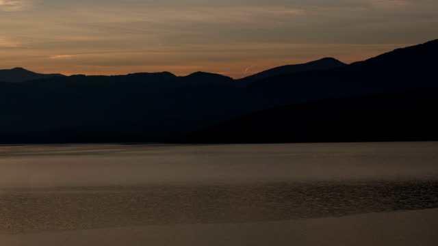 Lac du Sainte-Croix lake at sunrise time lapse Verdon Gorge in background