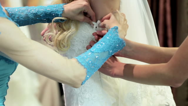 Lacing wedding dress Mother of the Bride helps lace wedding dress tulle netting stock videos & royalty-free footage