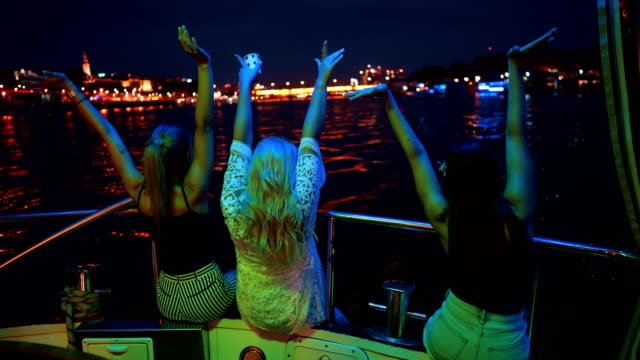 ladies enjoying on the boat at night - bachelorette party stock videos and b-roll footage